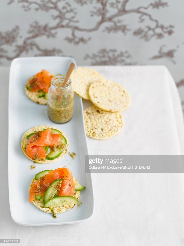 Crackers with salmon and cucumber