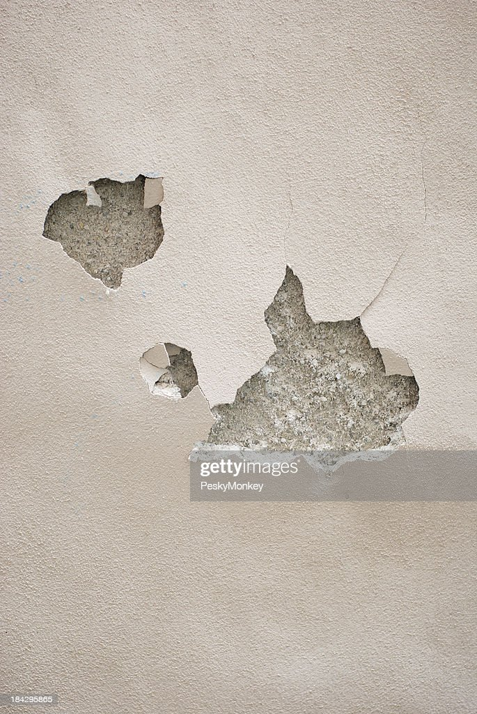 Cracking Holes in Stucco Wall Background