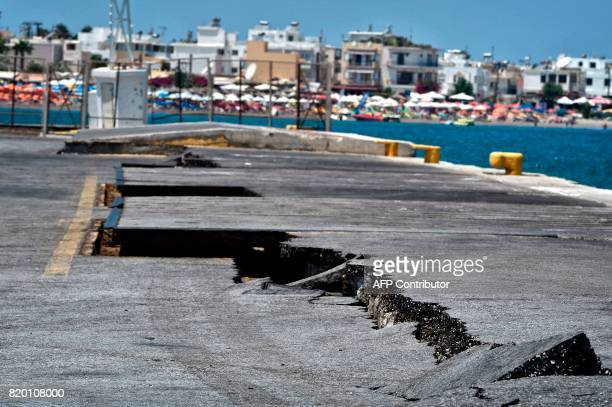 TOPSHOT Cracks are seen at the main port on the island of Kos on July 21 following a 65 magnitude earthquake which struck the region Two foreigners...