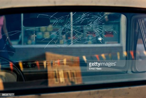 Cracks in the rear windscreen of a car circa 1970