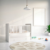 Child's room with a blank framed poste