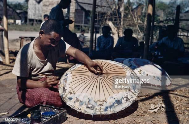 A craftsman decorating a parasol Myanmar circa 1950 Original publication Picture Post 4748 Burma