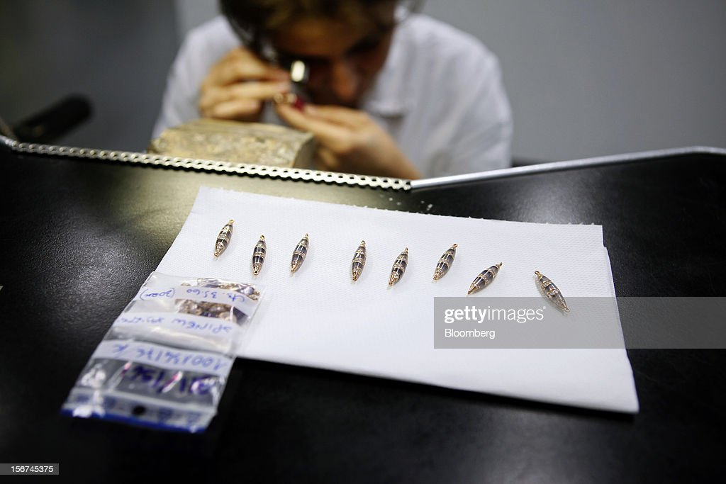 A craftsman examines a section of jewelry inside Bulgari SpA's workshop, a luxury unit of LVMH Moet Hennessy Louis Vuitton SA, in Rome, Italy, on Monday, Nov. 19, 2012. Last year's acquisition of Bulgari 'has brought a lot of jewelry know-how' to the company, said Francesco Trapani, president of LVMH's watch and jewelry division, who joined the Paris- based luxury-goods maker as part of the deal. Photographer: Alessia Pierdomenico/Bloomberg via Getty Images