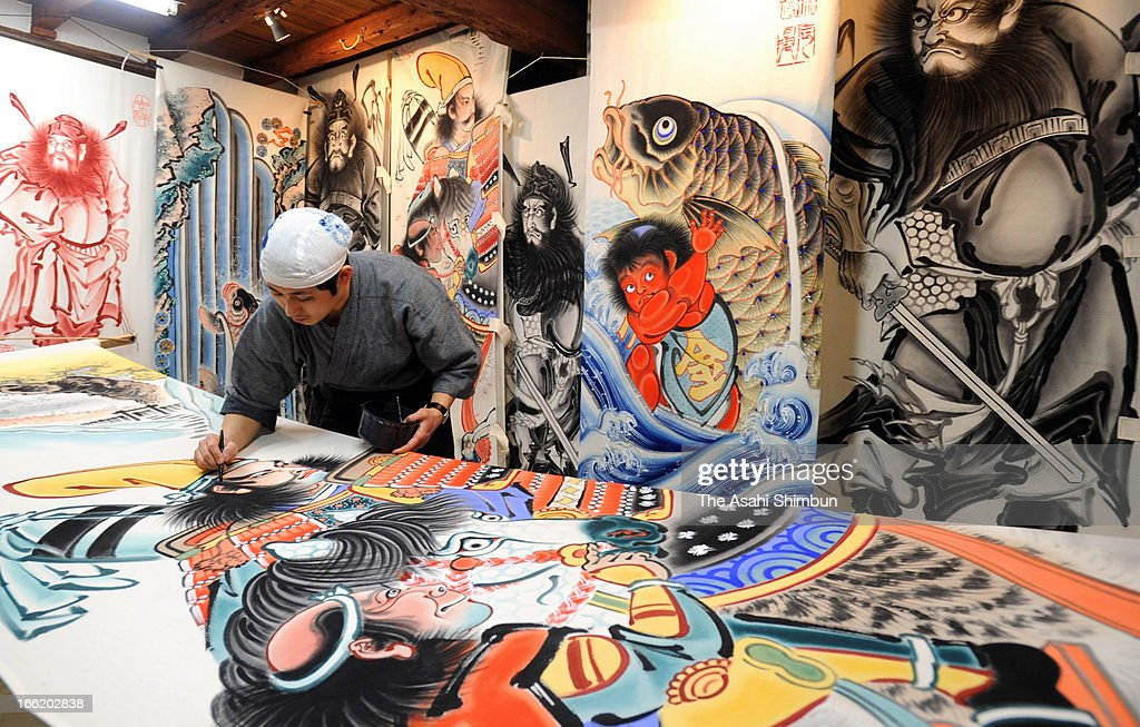 Craftsman Hiroyuki Yoshida draws on a flag at his studio on April 6, 2013, in Iwaki, Fukushima, Japan. The flags, known as 'E Nobori' or 'Painted Flags' that is displayed to celebrate the Boy's day on May 5, when people wish their sons' good health and prosperous future.