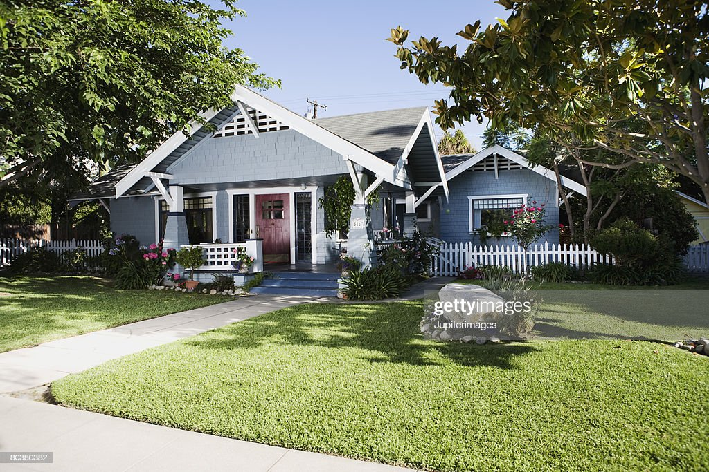 craftsman home exterior and front yard stock photo