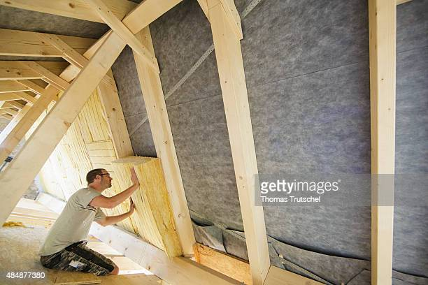 Craftsman insulating the interior room of a house under the roof on August 21 2015 in Berlin Germany