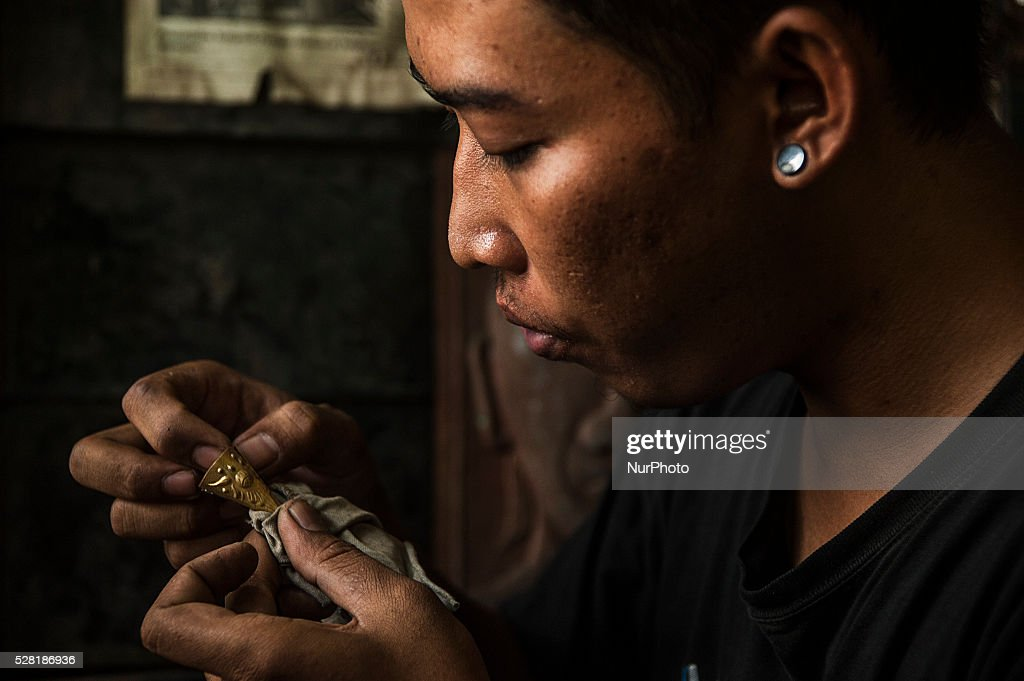 A craftsman make copper brass handicrafts in Kota Gede, Yogyakarta, Indonesia, on May 4, 2016. Crafters can make ornament copper handicrafts into necklaces, bracelets, rings and other ornaments with price IDR. 100,000 - IDR. 300,0000 appropriate motif and size