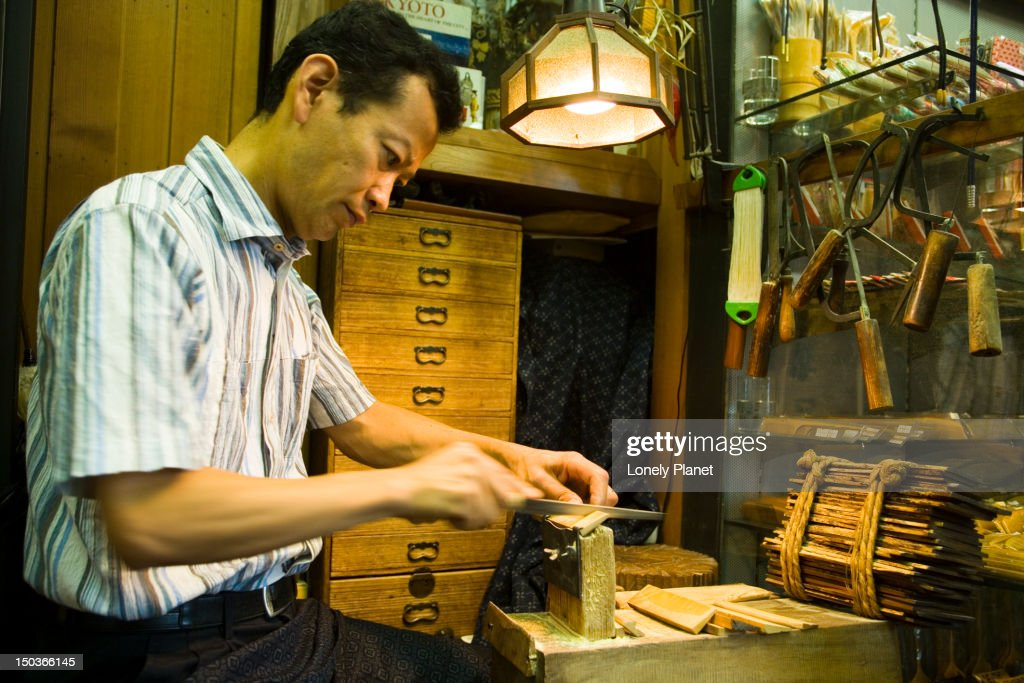 Craftsman making wooden combs at Jusan-Ya, The Number 13 Woodshop. : Stock Photo