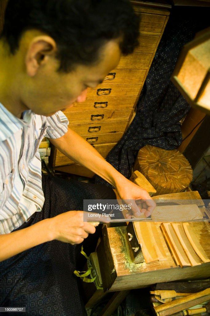 Craftsman making wooden combs at Jusan-Ya, The Number 13 Woodshop. : Stock Photo