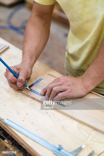 Craftsman measuring a piece of furniture