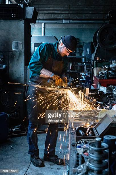 Craftsman repairman working with grinder