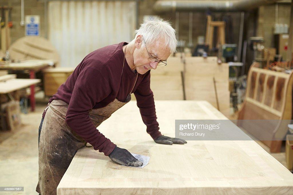 Craftsman sanding table in Furniture workshop : Stock Photo