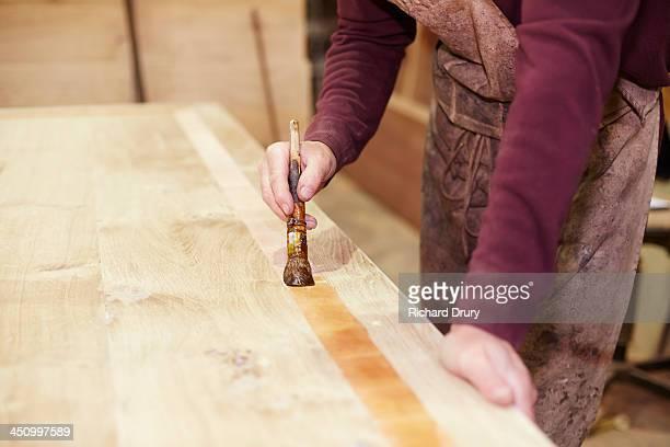 Craftsman sealing cross-beading on table