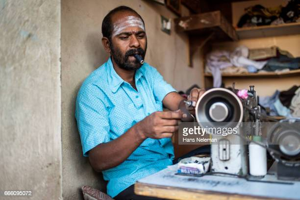 Craftsman using sewing machine to stitch clothes
