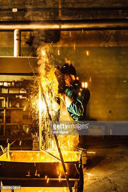 Craftsman welder  at work in a small factory