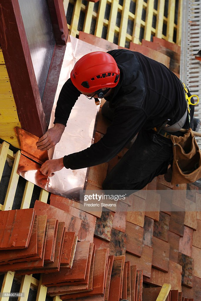 Craftsman working on the frame of the building of the monks in Abbey Royaumont on May 24, 2016 in Asnieres-Sur-Oise, France. The Royaumont foundation is undertaking extensive construction work to refurbish the Abbey and extend its residential facilities and is due to be finished in July 2016. The abbey's current owners, the Daudy family, are well known in France for their cultivation of artistic talent, their generous philanthropy and their visionary taste in music and dance, on one occasion inviting Pink Floyd to perform in the grounds in 1971.