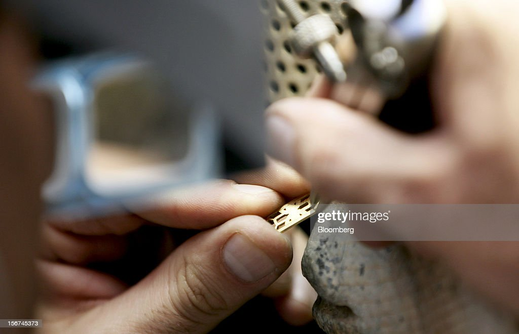 A craftsman works with a section of jewelry in Bulgari SpA's workshop, a luxury unit of LVMH Moet Hennessy Louis Vuitton SA, in Rome, Italy, on Monday, Nov. 19, 2012. Last year's acquisition of Bulgari 'has brought a lot of jewelry know-how' to the company, said Francesco Trapani, president of LVMH's watch and jewelry division, who joined the Paris- based luxury-goods maker as part of the deal. Photographer: Alessia Pierdomenico/Bloomberg via Getty Images