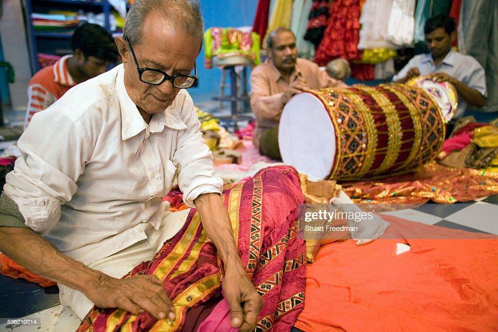 Craftsmen make costumes and props in a Mumbai workshop for the production of The Merchants of Bollywood Mumbai India The Merchants of Bollywood an...