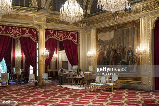 Craftsmen of the Mobilier National restore chairs at the Elysee Palace on August 12 in Paris The Mobilier national conserves repairs and maintains...