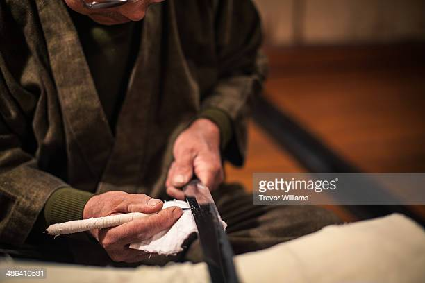 A craftsmen sharpens a traditional Japanese sword
