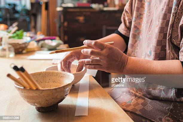 Craftsperson making a paper bowl
