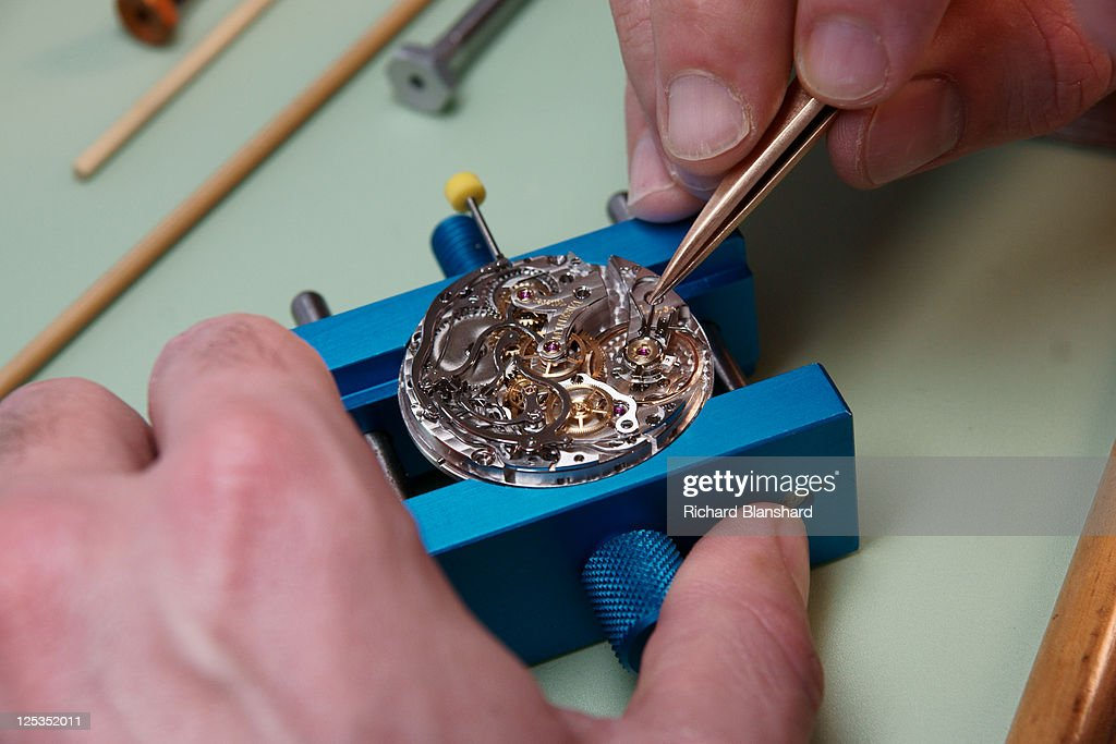 A craftsperson used tweezers to adjust a watch at the Montblanc factory, circa 2007.