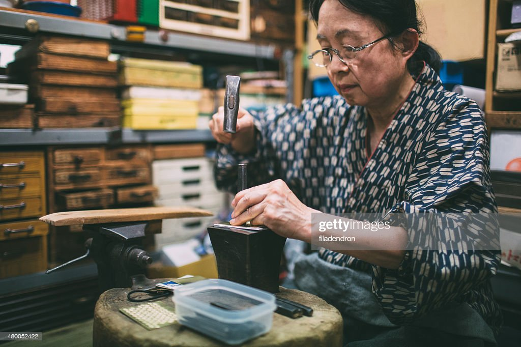 Craftswoman working on metal ornaments