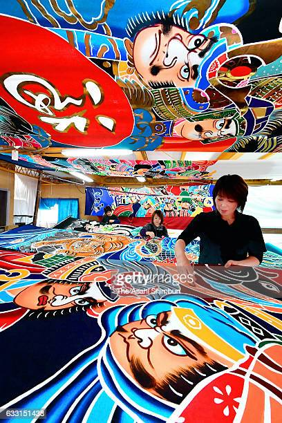 Craftswomen draw on a flag on January 30 in Ogi Saga Japan The flags known as 'Gogatu Nobori' or 'Satsuki Nobori' painted flags that is displayed to...