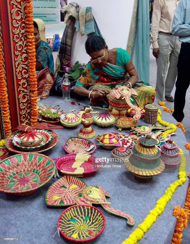 A craftswomen working on decorative earthen pots inside the Bihar pavilion during 32th India International trade Fair at Pargati Maiden on November 23, 2012 in New Delhi, India. IITF is the one of the largest trade fairs in Asia with participation of more than 7000 exhibitors from India and overseas.
