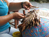 Craftwoman making a brazilian tipical art craft in Florianópolis, in the state of Santa Catarina.