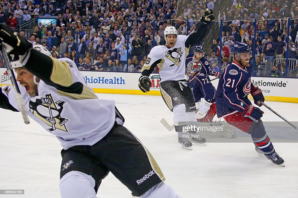 Craig Adams of the Pittsburgh Penguins and Brandon Sutter of the Pittsburgh Penguins celebrate after Adams scored a goal against the Columbus Blue...