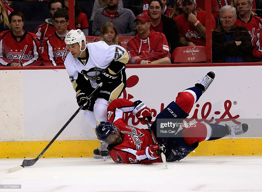 <a gi-track='captionPersonalityLinkClicked' href=/galleries/search?phrase=Craig+Adams&family=editorial&specificpeople=211144 ng-click='$event.stopPropagation()'>Craig Adams</a> #27 of the Pittsburgh Penguins and Joel Ward #42 of the Washington Capitals collide on the boards during the third period of the Penguins 3-2 at Verizon Center on March 10, 2014 in Washington, DC.
