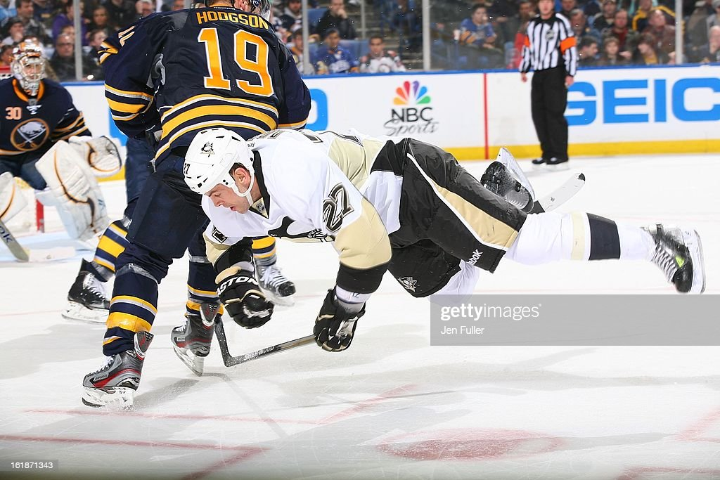 <a gi-track='captionPersonalityLinkClicked' href=/galleries/search?phrase=Craig+Adams&family=editorial&specificpeople=211144 ng-click='$event.stopPropagation()'>Craig Adams</a> #27 of the Pittsburgh Penguins is upended during a faceoff against Cody Hodgson #19 of the Buffalo Sabres on February 17, 2013 at the First Niagara Center in Buffalo, New York.