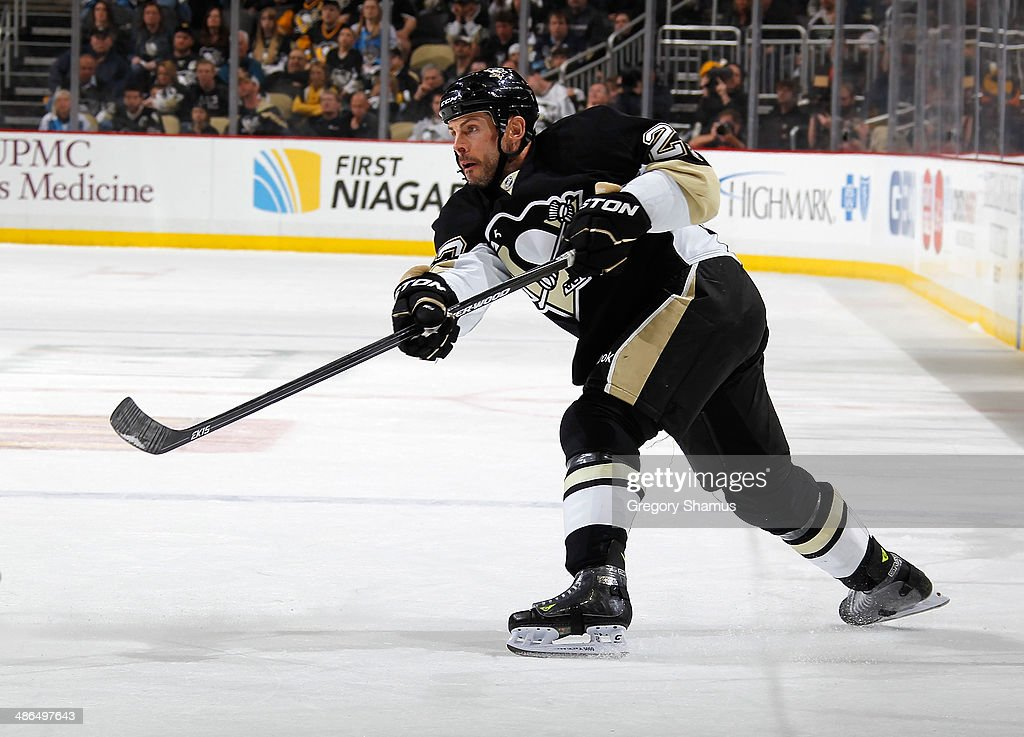<a gi-track='captionPersonalityLinkClicked' href=/galleries/search?phrase=Craig+Adams&family=editorial&specificpeople=211144 ng-click='$event.stopPropagation()'>Craig Adams</a> #27 of the Pittsburgh Penguins moves the puck against the Columbus Blue Jackets in Game Two of the First Round of the 2014 Stanley Cup Playoffs at Consol Energy Center on April 19, 2014 in Pittsburgh, Pennsylvania.