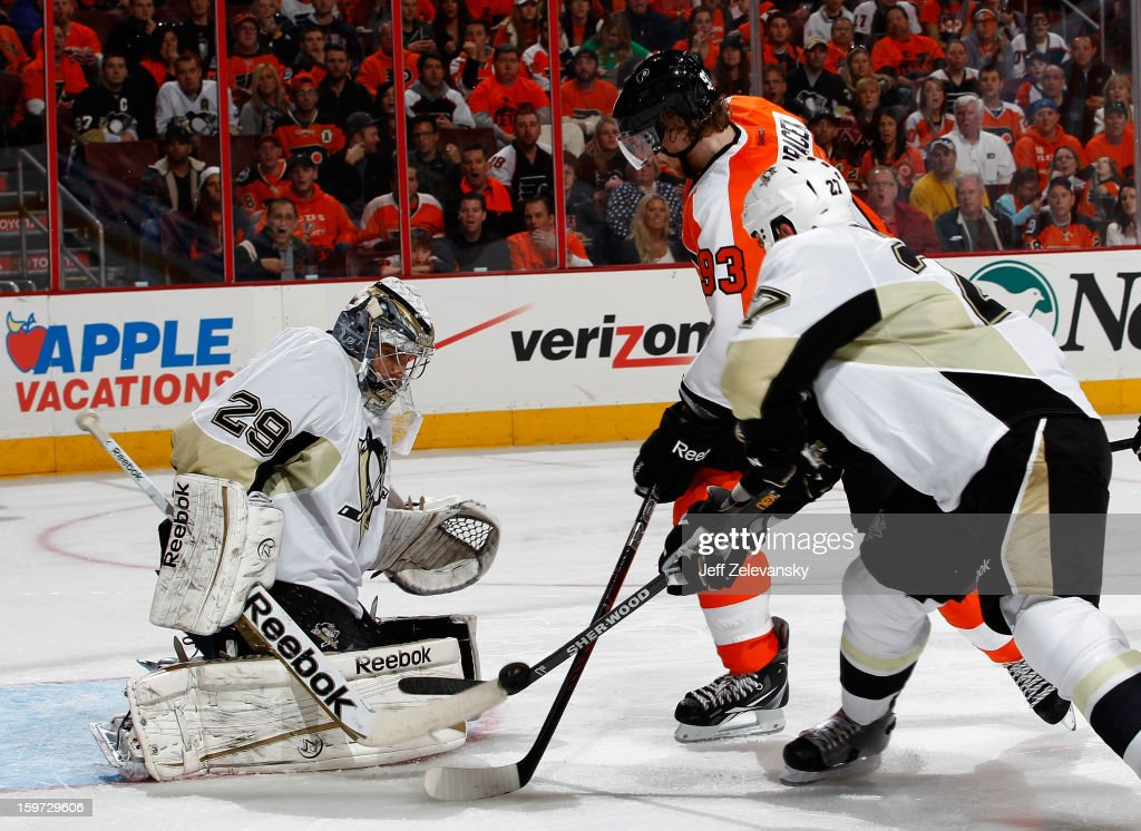 Craig Adams #27 of the Pittsburgh Penguins snags the puck from Jakub Voracek #93 of the Philadelphia Flyers in front of Marc-Andre Fleury #29 of the Penguins at Wells Fargo Center on January 19, 2013 in Philadelphia, Pennsylvania.