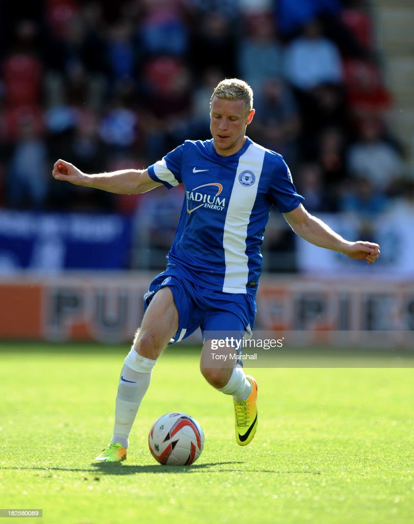 Craig Alcock of Peterborough United during the Sky Bet League One match between Rotherham United and Peterborough United at The New York Stadium on September 28, 2013 in Rotherham, England.