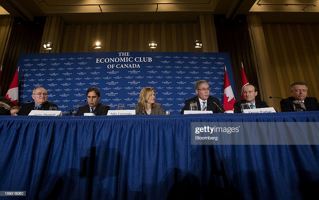Craig Alexander, chief economist of the Toronto-Dominion (TD) Bank Financial Group, from left, Avery Shenfeld, chief economist of Canadian Imperial Bank of Commerce (CBIC), Julia Coronado, chief economist of North America for BNP Paribas, Craig Wright, chief economist of RBC Financial Group, Doug Porter, deputy chief economist for BMO Capital Markets, and Warren Jestin, chief economist at Bank of Nova Scotia, attend the Economic Club of Canada's 2013 Annual Economic Outlook breakfast in Toronto, Ontario, Canada, on Friday, Jan. 11, 2013. Canada's dollar fell from the strongest in three months versus its U.S peer as the nation's trade deficit widened to the fourth-largest on record, suggesting the economy is struggling to emerge from an export-driven slump. Photographer: Norm Betts/Bloomberg via Getty Images