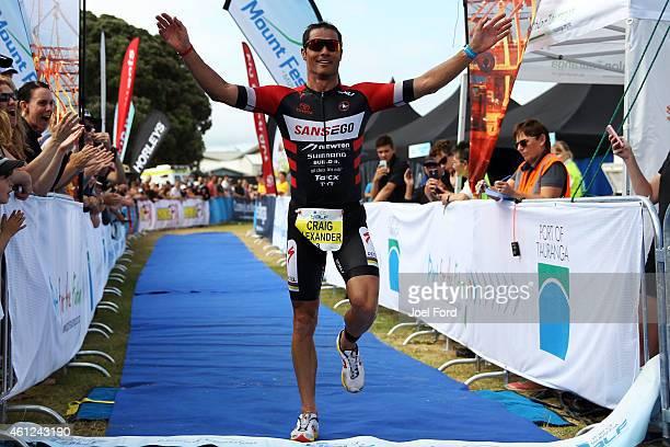 Craig Alexander crosses the finish line to win the Port of Tauranga Half Ironman on January 10 2015 in Tauranga New Zealand