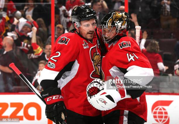 Craig Anderson and Dion Phaneuf of the Ottawa Senators celebrate after defeating the Pittsburgh Penguins with a score of 2 to 1 in Game Six of the...