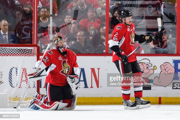 Craig Anderson and Dion Phaneuf of the Ottawa Senators react after a goal by the Pittsburgh Penguins in Game Six of the Eastern Conference Final...