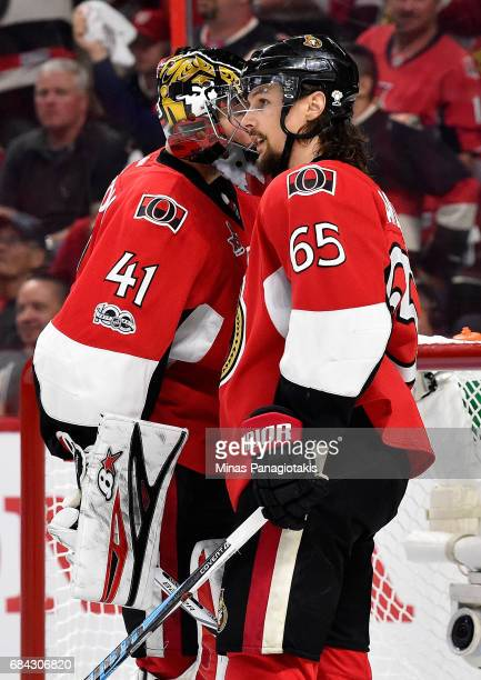 Craig Anderson and Erik Karlsson of the Ottawa Senators talk against the Pittsburgh Penguins during the second period in Game Three of the Eastern...