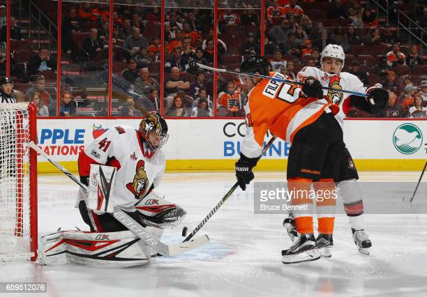 Craig Anderson and JeanGabriel Pageau of the Ottawa Senators defend against Valtteri Filppula of the Philadelphia Flyers during the second period at...