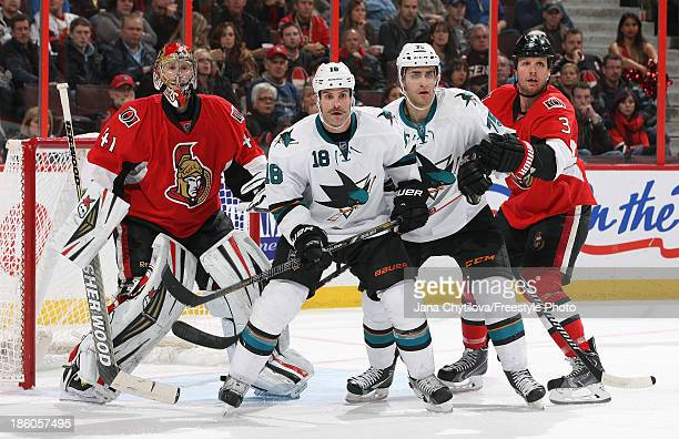 Craig Anderson and Marc Methot of the Ottawa Senators defend against Mike Brown and Freddie Hamilton of the San Jose Sharks during an NHL game at...