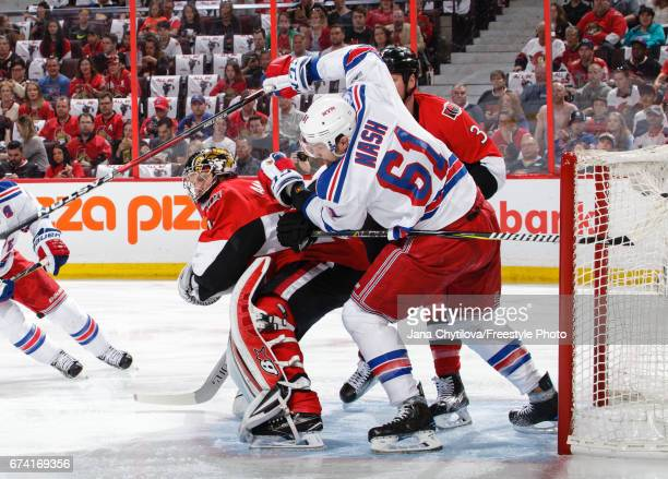 Craig Anderson and Marc Methot of the Ottawa Senators defend against Rick Nash of the New York Rangers in Game One of the Eastern Conference Second...