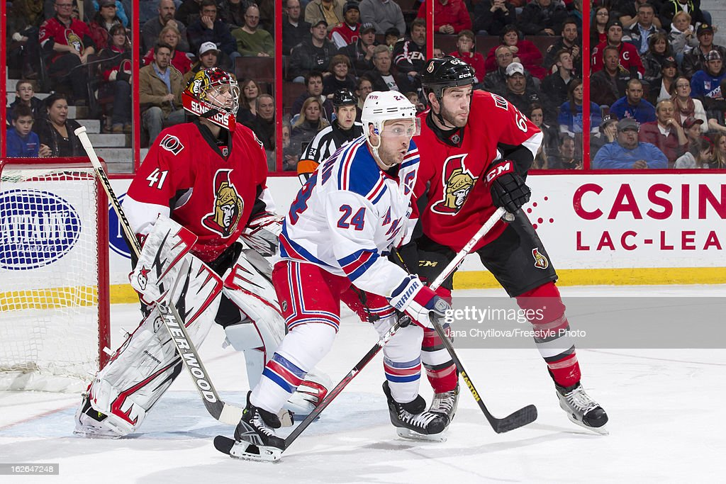 Craig Anderson #41 of the Ottawa Senators attempts to follow the play through a screen of Ryan Callahan #24 of the New York Rangers and Eric Gryba #62 of the Ottawa Senators during an NHL game at Scotiabank Place on February 21, 2013 in Ottawa, Ontario, Canada.