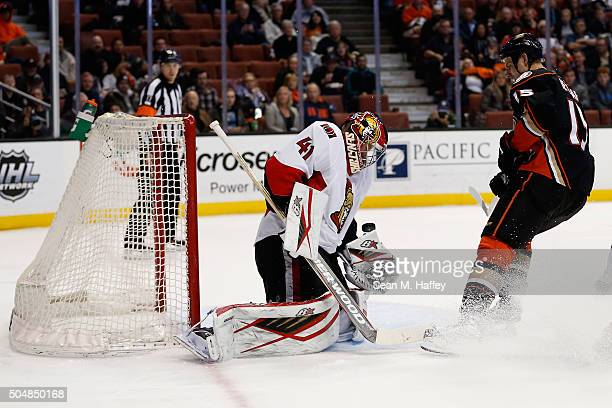 Craig Anderson of the Ottawa Senators blocks a shot on goal by Ryan Getzlaf of the Anaheim Ducks during the first period of a game at Honda Center on...