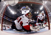 Craig Anderson of the Ottawa Senators can't make a save on a shot by Chris Kunitz of the Pittsburgh Penguins in Game One of the Eastern Conference...