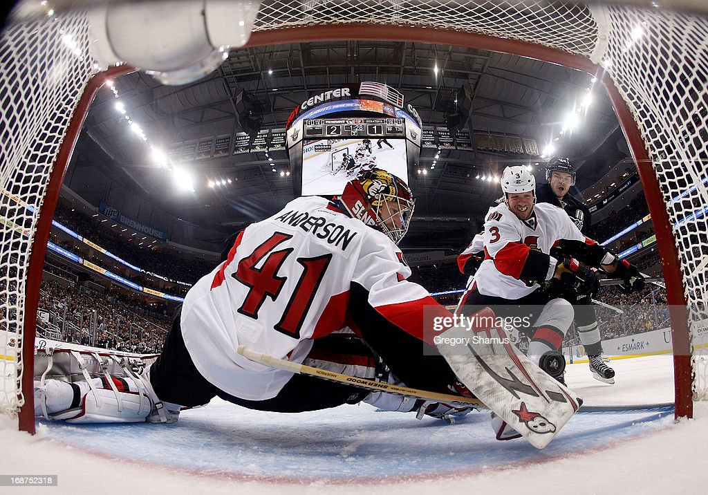 <a gi-track='captionPersonalityLinkClicked' href=/galleries/search?phrase=Craig+Anderson&family=editorial&specificpeople=211238 ng-click='$event.stopPropagation()'>Craig Anderson</a> #41 of the Ottawa Senators can't make a save on a shot by <a gi-track='captionPersonalityLinkClicked' href=/galleries/search?phrase=Chris+Kunitz&family=editorial&specificpeople=604159 ng-click='$event.stopPropagation()'>Chris Kunitz</a> #14 of the Pittsburgh Penguins in Game One of the Eastern Conference Semifinals during the 2013 NHL Stanley Cup Playoffs at Consol Energy Center on May 14, 2013 in Pittsburgh, Pennsylvania.