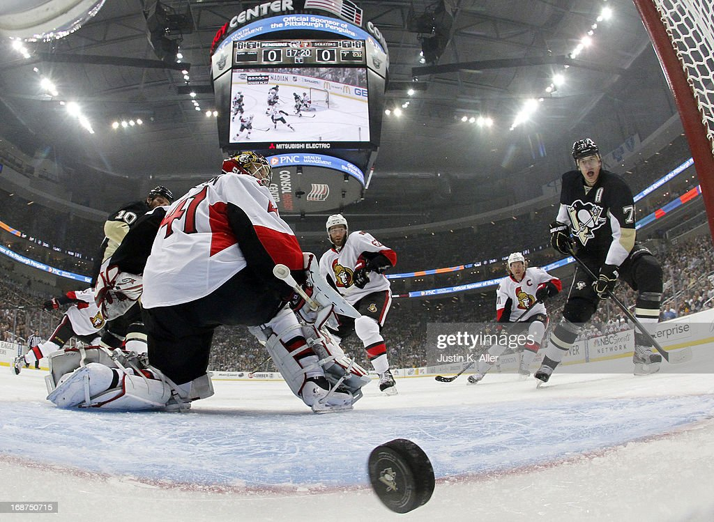 <a gi-track='captionPersonalityLinkClicked' href=/galleries/search?phrase=Craig+Anderson&family=editorial&specificpeople=211238 ng-click='$event.stopPropagation()'>Craig Anderson</a> #41 of the Ottawa Senators can't stop a goal by Paul Martin #7 of the Pittsburgh Penguins (not pictured) in Game One of the Eastern Conference Semifinals during the 2013 NHL Stanley Cup Playoffs at Consol Energy Center on May 14, 2013 in Pittsburgh, Pennsylvania.