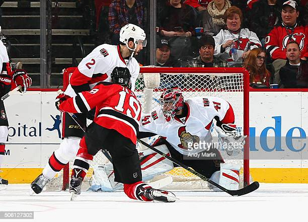 Craig Anderson of the Ottawa Senators can't stop a goal by Travis Zajac of the New Jersey Devils during the game at the Prudential Center on January...